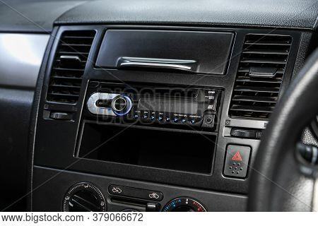 Novosibirsk/ Russia - July 26 2020: Nissan Tiida Latio, Audio Stereo System, Control Panel And Cd In