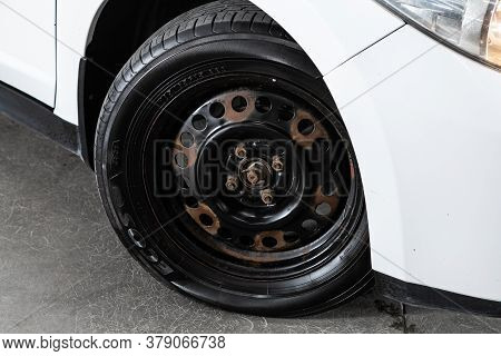 Novosibirsk/ Russia - July 26 2020: Nissan Tiida Latio, Car Wheel On White  Car - Close Up