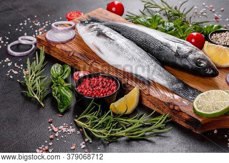Fresh Fish Seabass And Ingredients For Cooking. Raw Fish Seabass