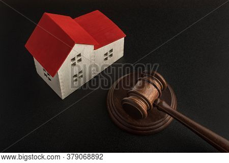 Gavel Of Judge And Model House. Confiscated Housing. Resolving Property Disputes.
