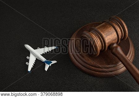 Wooden Judges Gavel And Toy Plane. Aviation Law. Lawsuit With The Airline.