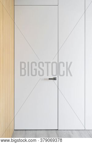 Vertical Photo Of Wooden Wardrobe In Hall At Contemporary House. Element Of Interior Design With Clo