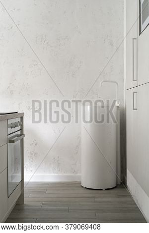 Vertical Photo Of Element Modern Kitchen Room With Furniture, Cupboards, White Concrete Sink, Water