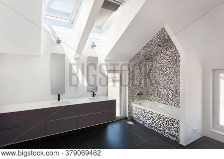 Side View Of Modern House With Contemporary Interior Design In Bathroom, White Bathtub, Washstand On