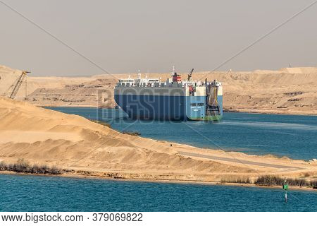 Ismailia, Egypt - November 14, 2019: Vehicles Carrier Vessel Dignity Ace Passing Suez Canal In Egypt