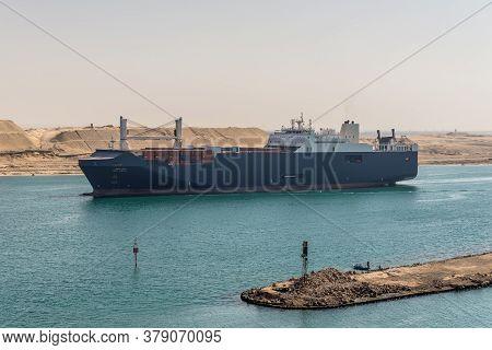 Suez, Egypt - November 14, 2019: Ro-ro Cargo Vessel Bahri Hofuf Passing Suez Canal In Egypt. The Sue