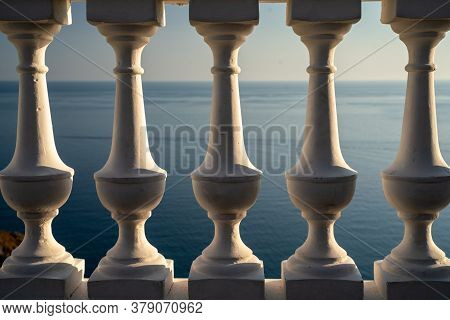 Classic Balustrade On The Embankment Against The Sea. White Balcony Over The Sea. Promenade With A B