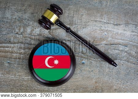 Wooden Judgement Or Auction Mallet With Of Azerbaijan Flag. Conceptual Image.