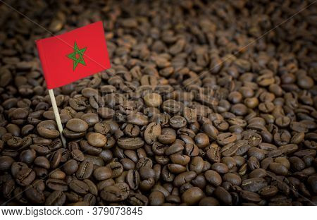 Morocco Flag Sticking In Roasted Coffee Beans. The Concept Of Export And Import Of Coffee
