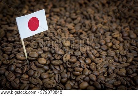 Japan Flag Sticking In Roasted Coffee Beans. The Concept Of Export And Import Of Coffee