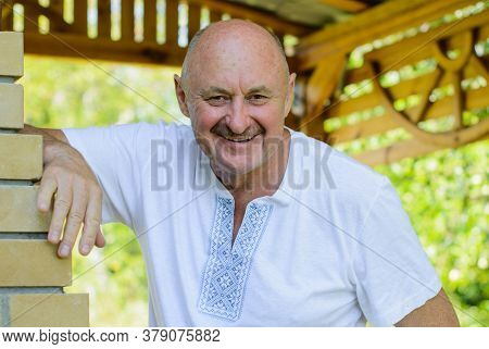 A Mature Man In An Embroidered Shirt On A Nature. Organization And Association Of Slavic Peoples Abr