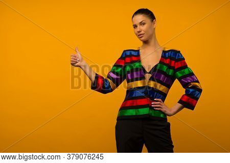 Young Lesbian Girl And An Lgbt Community Representative Posing In A Flag Coloring Jacket Lgbtq Showi