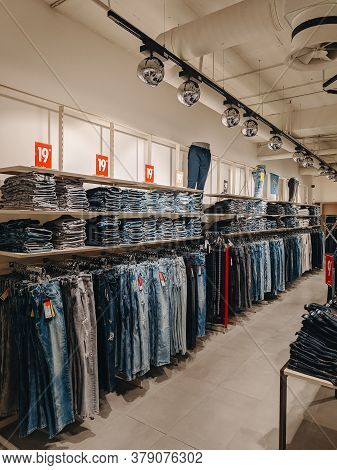 Budva, Montenegro - 01 August 2020: Jeans In The Store. The Goods Are On The Shelves. Stylish Fashio