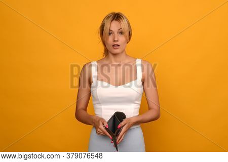 Young Woman Shows Her Empty Wallet. Bankruptcy - Image