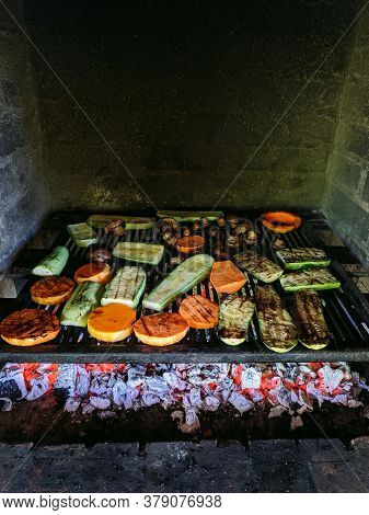 Grilled Vegetables. Courgette, Mushrooms And Pumpkin On A Metal Grill Over Red Coals.