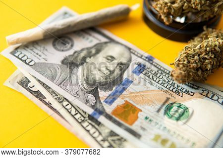 Marijuana Weed Bud And Grinder. Cannabis Nature Bud. Joint Weed. Yellow Background.