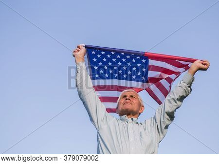 Patriotic Senior Man Celebrates Usa Independence Day On 4th Of July With A National Flag In His Hand