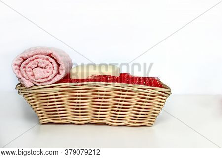 Different Soap Bars And Basket With Towels On Table. Space For Text. Covid 19. Towel And Soap. Pink