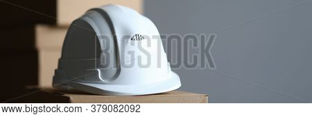 Cardboard Box Lies White Protective Helmet Builder. Providing Workers With Personal Protective Equip