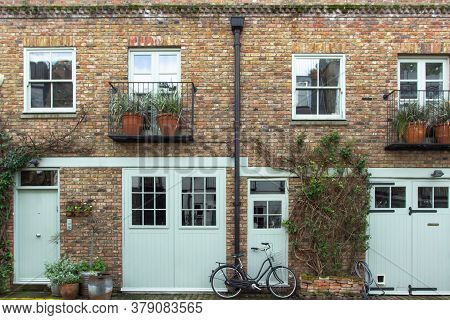 Bicycle Parking In Front Of A Residential House In London, Uk. Block Of London Houses. English Archi