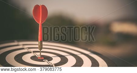 Bullseye Or Dart Board Has Dart Arrow Throw Hitting The Center Of A Shooting Target With Sunshine Fo