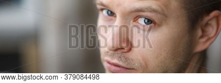 Close-up Of Male Posing On Camera. Macro Shot Of Attractive Man Model With Serious Expression. Pensi