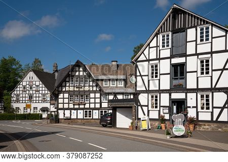 Schmallenberg, Germany - June 12, 2020: Image Of Old Half-timbered Houses Against Blue Sky In Summer