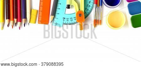 School Supplies As A Frame On A White Background, Close-up. Back To School Concept. Top View, Flat L