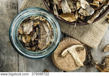 Dried Porcini Mushrooms In A Storage Jar. View From Above.