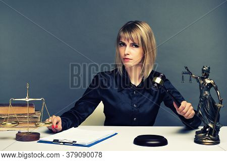 A Young Fair Woman Judge Works In Her Office. - Image
