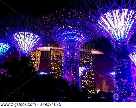 Singapore, March 6, 2016: Night View Of The Artificial Trees Of The Gardens Of The Bay With Its Spec