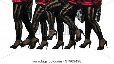 Female Legs In Black Stockings And High Heels