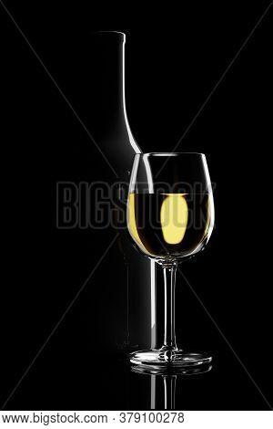 Glass Of White Wine Next To A Bottle Backlit On A Black Background. 3d Illustration.