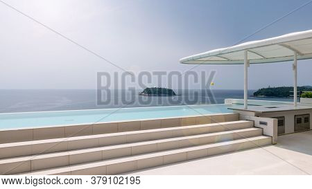 Swimming Pool Overlooking View Andaman Sea And Clear Sky Background And Lens Flare Copy Space For Su