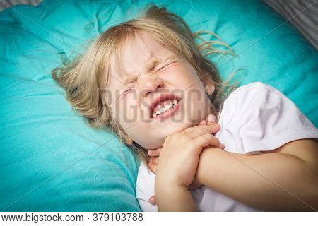 A Little Girl Fell Ill With A Sore Throat. Sore Throat In A Child.