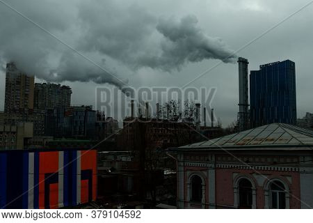 Kyiv, Ukraine, February 25, 2020. Smoke Comes From Chimneys Over The City On A Cloudy Day. Ugly City
