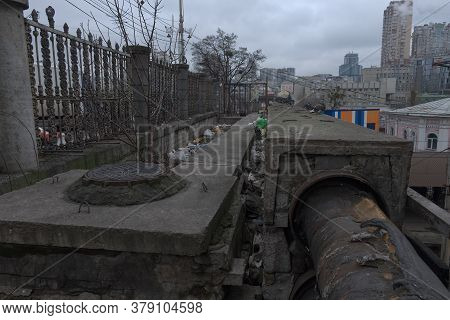 Kyiv, Ukraine, February 25, 2020. Old Sewer Manhole. Cloudy City Landscape. Dirty City.