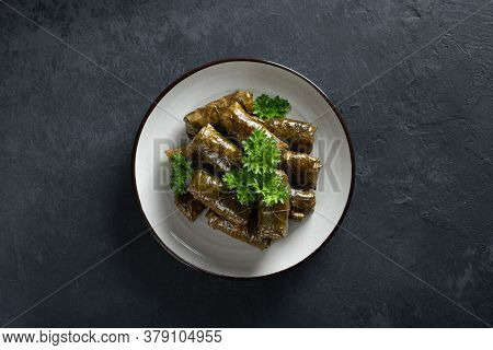 Dolma - Stuffed Grape Leaves With Rice And Meat On A Dark Background, View From Above, Copy Space. T