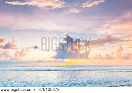 Morning seascape, beautiful sunrise in cloudy sky over the sea