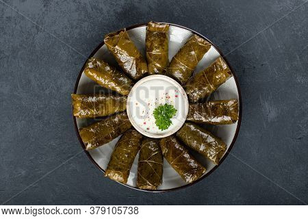Dolma - Stuffed Grape Leaves With Rice And Meat On A Dark Background, View From Above. Traditional G