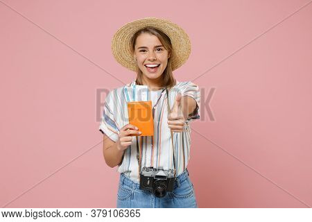 Funny Young Girl In Striped Shirt Hat With Photo Camera Isolated On Pink Background. Passenger Trave