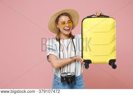 Cheerful Tourist Girl In Striped Shirt Glasses Hat With Photo Camera Isolated On Pink Background. Pa