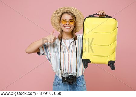 Smiling Girl In Shirt Glasses Hat With Photo Camera Isolated On Pink Background. Passenger Traveling