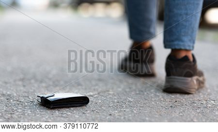 Money Loss Concept. Person Has Lost His Wallet On City Street, Close Up Of Notecase Lying On The Roa