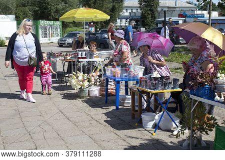 Uglich, Russia, - 26 July 2020, Elderly Women Sell Blueberries, Mushrooms, Berries And Vegetables In