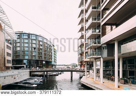 Oslo, Norway - June 24, 2019: View Of Residential Multi-storey Houses In Aker Brygge District In Sum