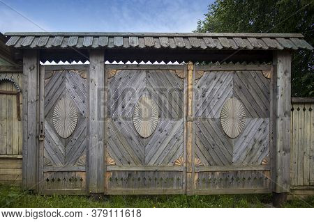 Carved Gates On The City Wooden Manor