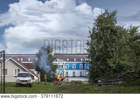 Myshkin, Russia - 26 July 2020 Children Are Making A Fire In Front Of The Central Hotel. Volga View