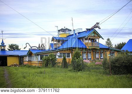Wooden House With A Dragon In The Village. Durasovo. Wooden Architecture, Architectural Monument
