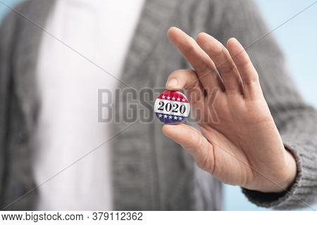 Incognito Voter Holding Vote Button On Blue Background For The November Elections In The United Stat